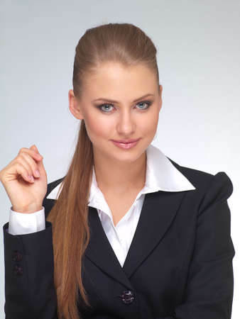 young woman manager in a suit against a light background Stock Photo - 9473337