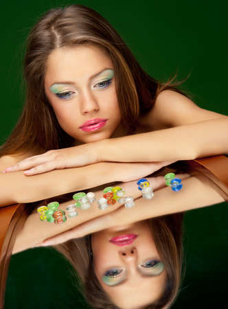 young brunette girl lying on the mirror Stock Photo - 9482722