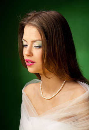 portrait of a pretty girl on the green background Stock Photo - 9519876