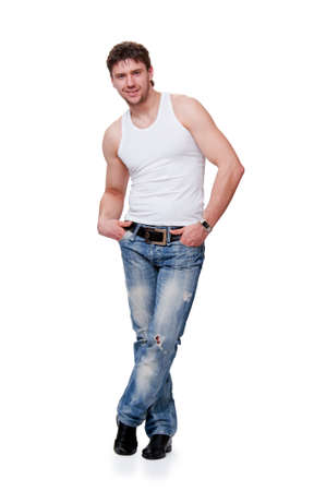 young man in jeans  is on an isolated background Stock Photo