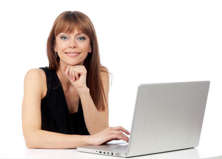woman with a smile on his face and a laptop computer on the desk, isolated background