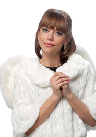 portrait of a woman brunette in a white coat and wings on the isolated background. Symbolizes an angel.