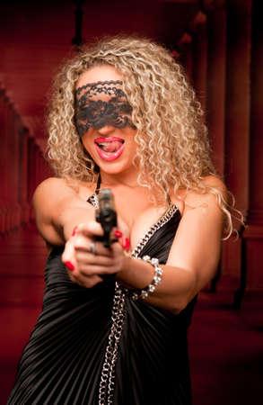 beautiful woman with a gun Stock Photo - 9914028
