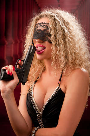 beautiful woman with a gun Stock Photo - 9914025