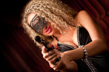 beautiful woman with a gun Stock Photo - 9914241