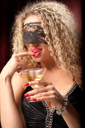 beautiful woman with a glass of liquor Stock Photo - 9908448