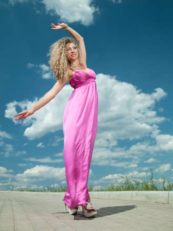 attractive woman in a pink dress Stock Photo - 9908451