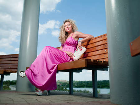 woman in a pink dress stands near the column Stock Photo - 9883056