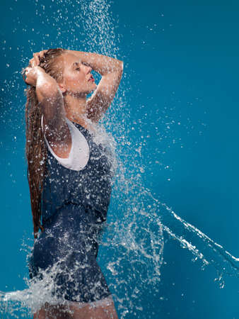 wet lips: woman in a bathing suit and a jet of water Stock Photo