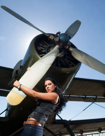 beautiful woman in jeans and sport aircraft Stock Photo