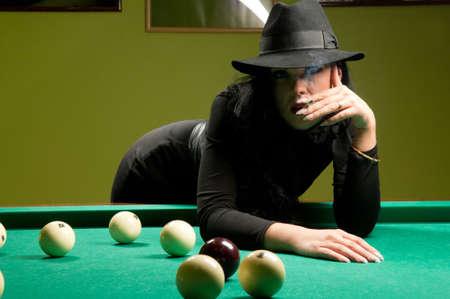 beautiful woman wearing a hat in the billiard club Stock Photo - 10159711