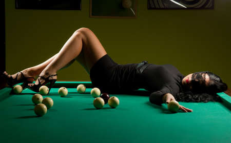 beautiful woman wearing a hat in the billiard club Stock Photo