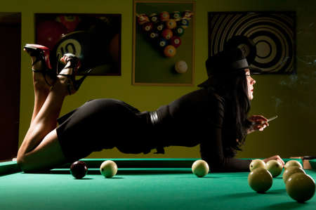 beautiful woman wearing a hat in the billiard club photo