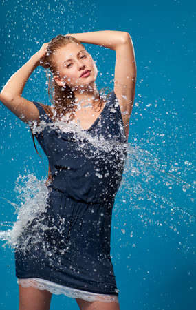 wet lips: woman in wet clothing under running water
