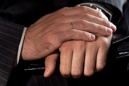 the hands of a businessman carrying a briefcase