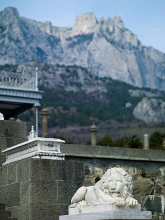 The ancient monument of a lion in the palace on a background of mountains