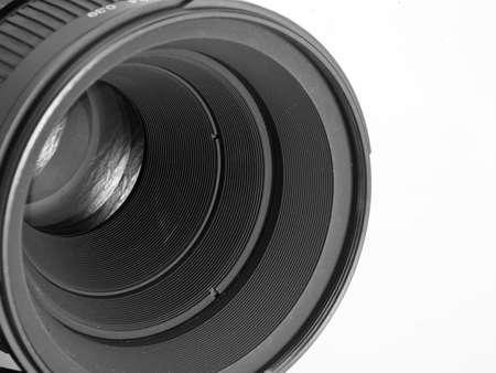 Lens of the camera with a reflection on the lens on a white background Stock Photo - 12370057