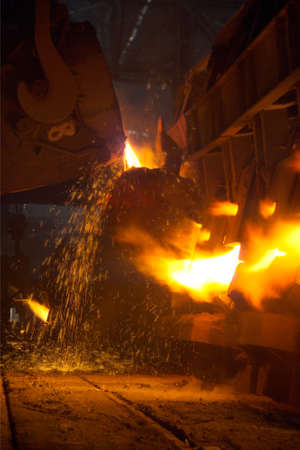 melting metal in a foundry photo