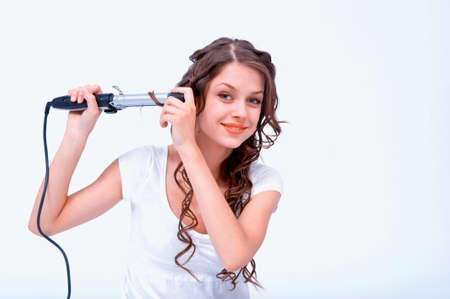 Girl with a curling looks at the camera smiling Stock Photo - 12632929
