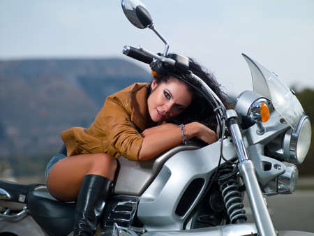 Beautiful girl on motorcycle photo