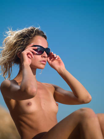 nude girl with glasses against the sky Stock Photo