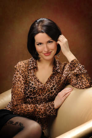 portrait of brunette with brown eyes sitting on the couch photo