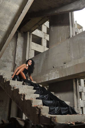 Beautiful Brunette in evening dress at a construction site Stock Photo - 13210729