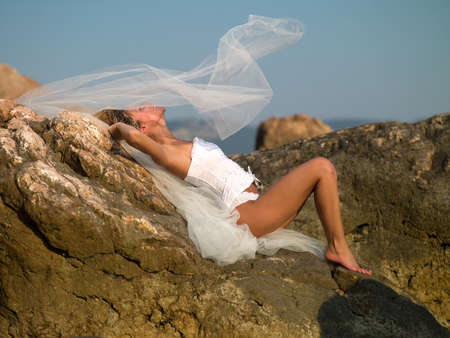 Beautiful bride by the sea photo