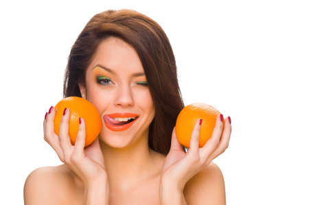 beautiful girl with bright makeup and oranges Stock Photo - 13361080