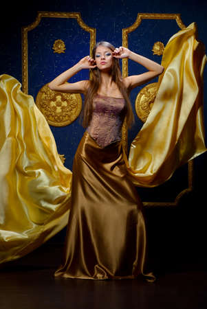 beautiful girl in vechernemplate gold color in the interior