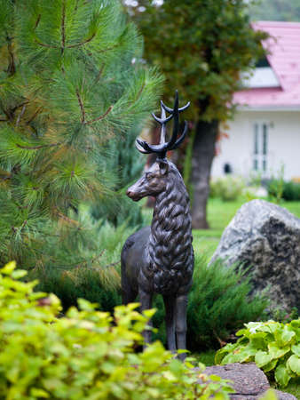 sculpture of a deer from the metal into the trees with sunlight Stock Photo - 13559643