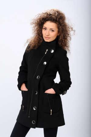 beautiful girl in a black coat Stock Photo - 13576433