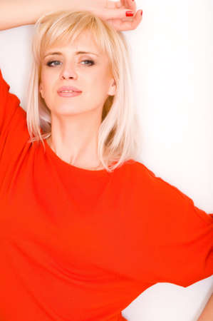 Pretty girl in red clothes near a neutral background Stock Photo - 13696423