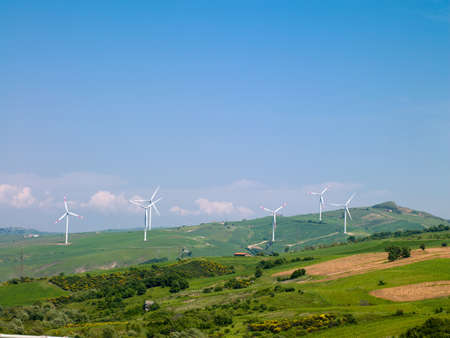 wind energy: wind farms in Italy against the blue sky and nature