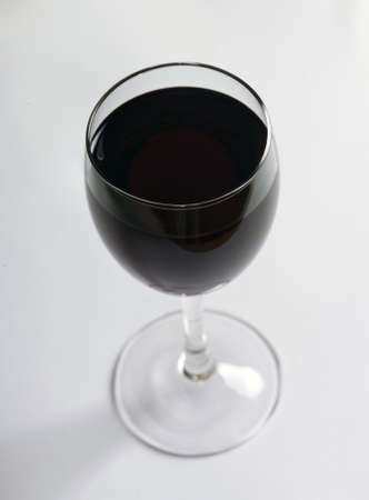 bacchus: glass of red wine on a white background