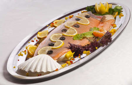 dish with fish on a plate lined with beautiful fruit photo