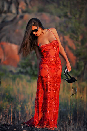 girl in a red dress and glasses on the street Stock Photo - 16114629