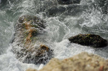 water beating on the stone in the foaming waves sea Stock Photo - 16164934
