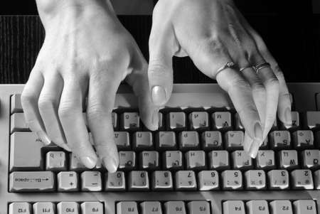 Women's gentle hands typing on a keyboard Stock Photo - 16154697