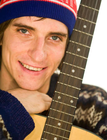 young guy a guitar in his hands looking at the camera Stock Photo - 17668571