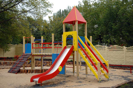 children playground outdoor in the yard of houses photo