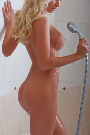naked black women: nude girl posing in the flat interior