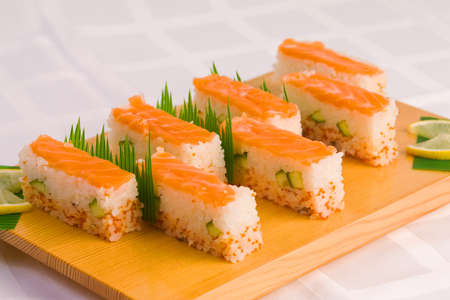 Japanese dish eating sushi with chopsticks on a plate is lined photo