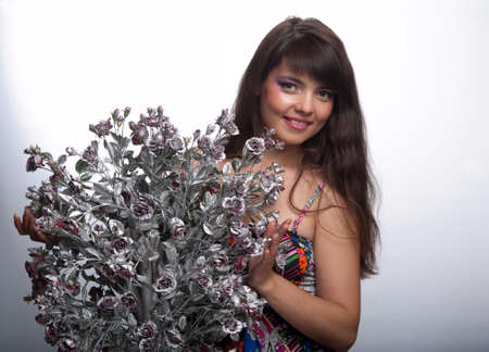 brunette model girl with an artificial flower Stock Photo - 17668940