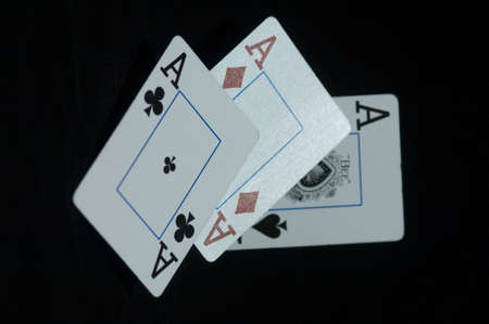 playing cards spread out on a black background photo