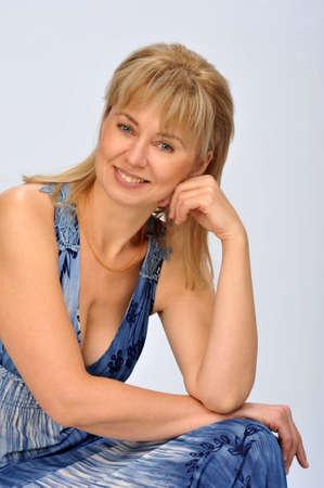female model posing for the camera in a photo studio photo