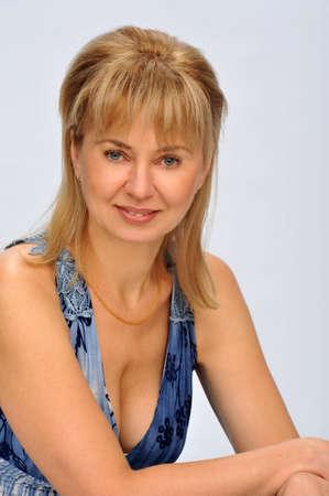 female model posing for the camera in a studio photo