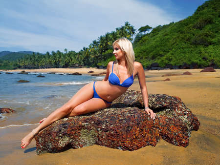 girl in a bathing suit on the island rests in the sky Stock Photo - 17698461