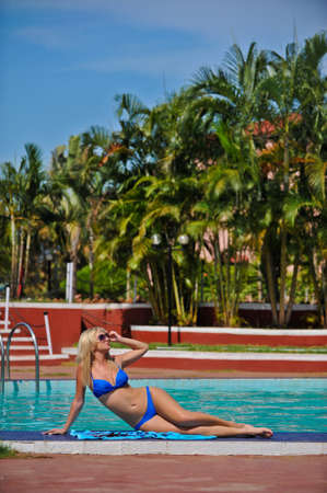 a girl in a bathing suit on the island rests in the sky Stock Photo - 17698440