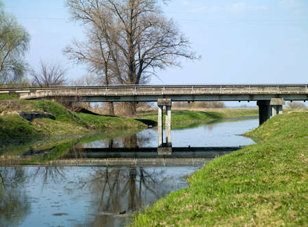 Photo of the old bridge next to a small river in the sky Stock Photo - 17668570